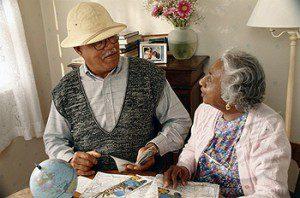 BLACK OLDER COUPLE PLANNING VACATION