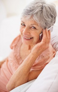 closeup_portrait_of_a_smiling_senior_woman_talking_over_the_cellphone